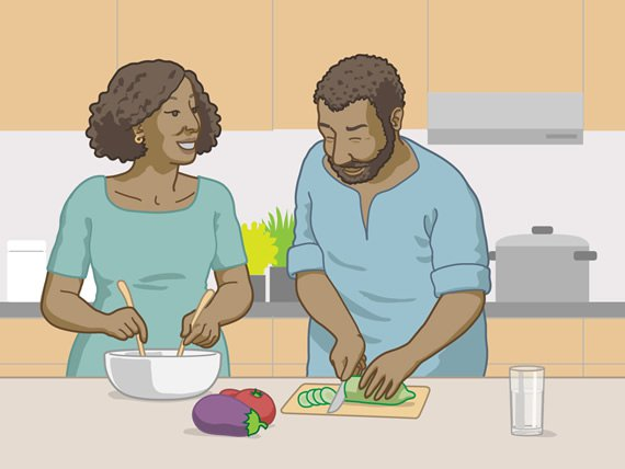 A woman and a man having fun in the kitchen while preparing a meal together.